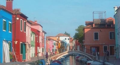 Colourful houses along a canal in Venice