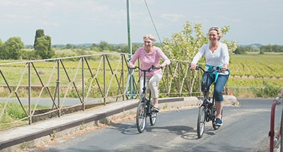 Cycling across a bridge on the Canal du Midi